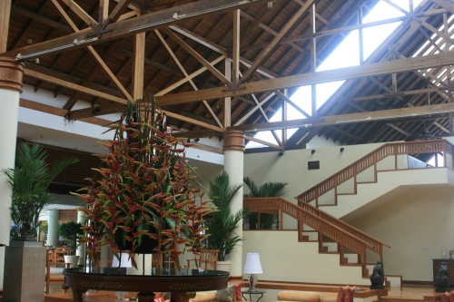 The wooden ceiling and beautiful centerpiece,Leela Kovalam lobby