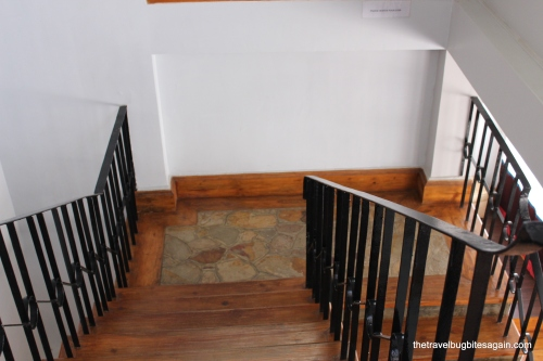 The artistic wooden stairs and tiled floor